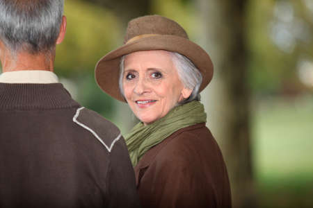 Elegant woman looking over her shoulder photo