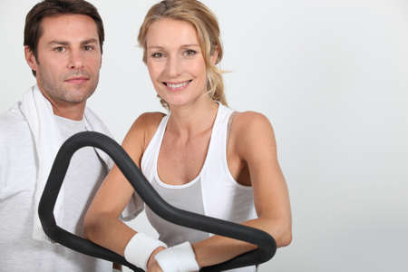 Couple working out in a gym Stock Photo - 16669582