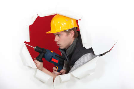 Tradesman demolishing a wall Stock Photo - 16730279