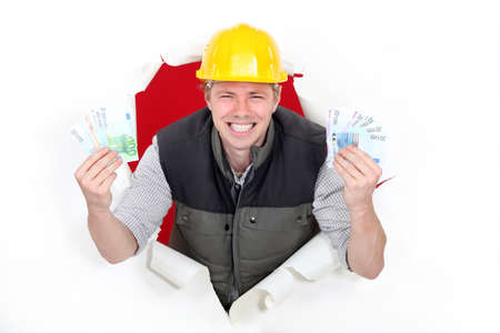 exultant: craftsman rejoicing over purchase power Stock Photo