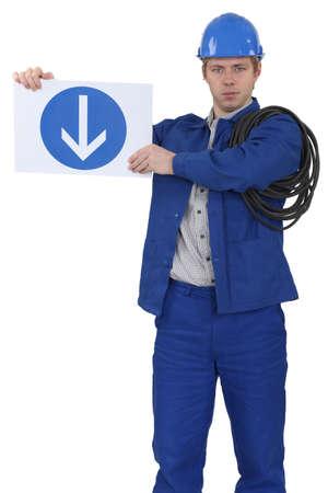 menacing: Menacing traffic guard holding a sign