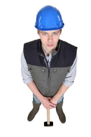 Man posing with sledge hammer Stock Photo - 16729385