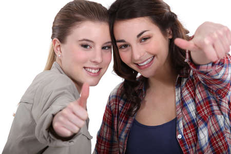 commend: Young women giving the thumbs up