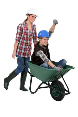 Women with a wheelbarrow Stock Photo - 16729921