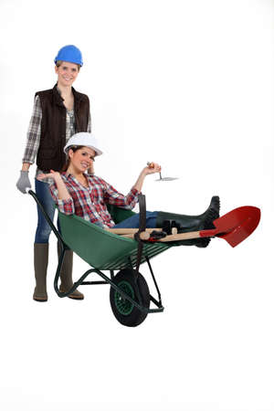 Two women with wheelbarrow photo
