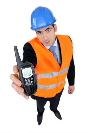 Foreman holding radio receiver Stock Photo - 16716471