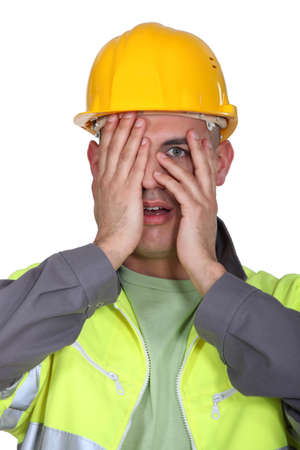 premonition: Tradesman afraid to look Stock Photo