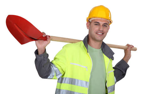 laborers: Tradesman carrying a spade on his shoulders Stock Photo