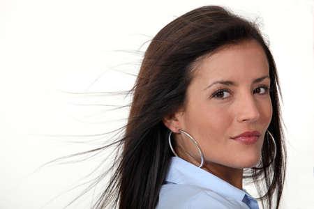 Brunette wearing hoop earrings Imagens