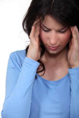 Woman with a headache Stock Photo - 16732107