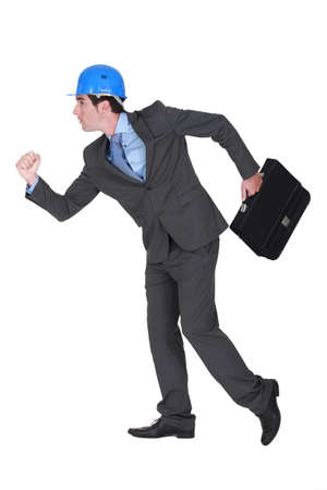 head wear: Architect running with briefcase Stock Photo