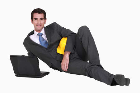 prime adult: Architect laying on floor with laptop
