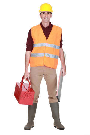 safety vest: full-length portrait of man with toolcase