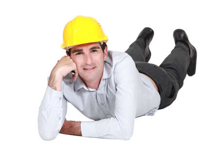 Architect laying on the floor resting Stock Photo - 16729378
