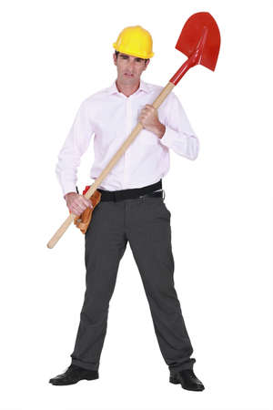 Businessman with a hardhat and shovel photo