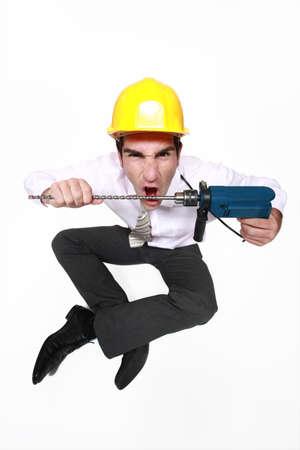 man nuts: A mad architect biting a drill.