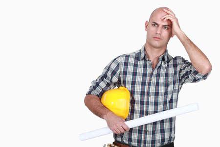 frowning: An angry tradesman