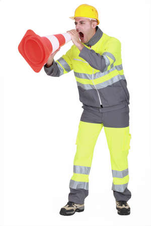 utility: road worker shouting through a traffic cone