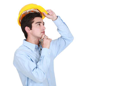 Young architect thinking. Stock Photo - 16729247