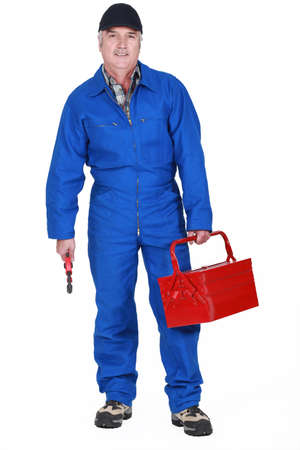 jumpsuit: Tradesman holding a tool and his toolbox