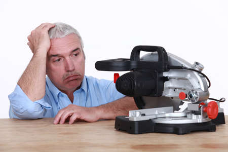 fedup: Man with circular saw looking fed-up