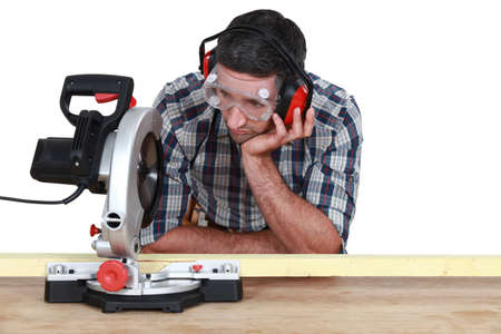 miter: Carpenter using miter saw Stock Photo