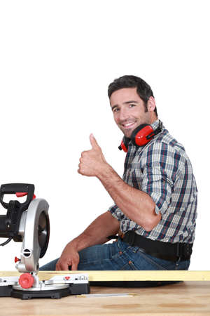 favourable: Approving tradesman using a mitre saw
