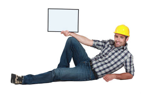 knees bent: Construction worker Stock Photo