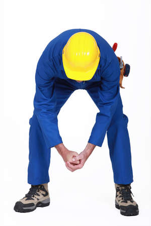 pawn adult: Worker bending over Stock Photo