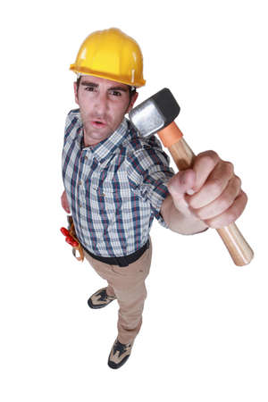 pry: Builder holding hammer Stock Photo