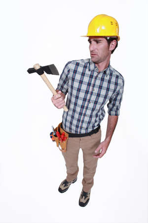 journeyman: A handyman looking weirdly at his hatchet.