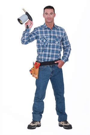 Handyman holding blow torch Stock Photo