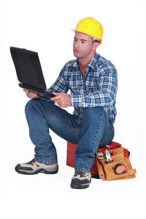 Tradesman checking his emails photo