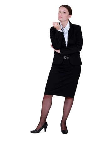 await: Businesswoman inspecting her nails
