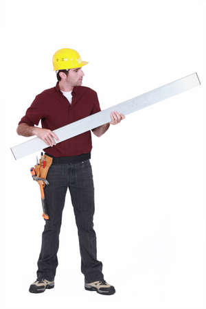 Tradesman holding up a steel girder photo