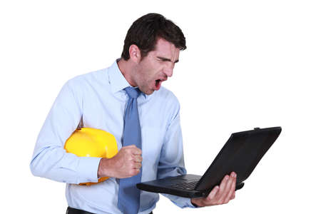 Architect shouting at laptop Stock Photo - 16779314