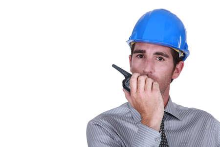Engineer using a walkie-talkie