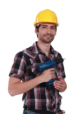 cordless: young craftsman holding a drill Stock Photo