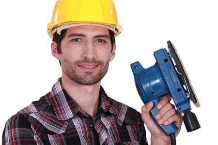 sander: Worker with a sander Stock Photo