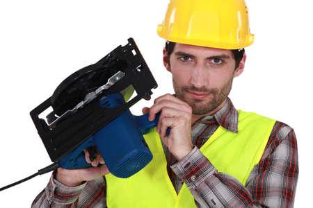 sander: craftsman holding sander machine