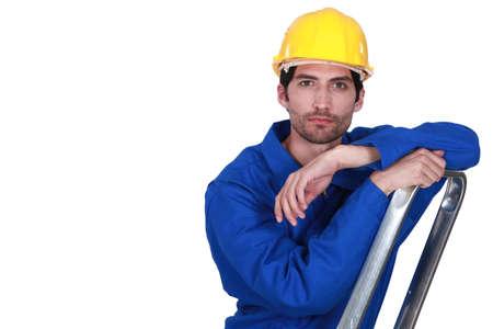Man climbing step-ladder photo