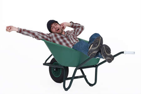 lazy: Man dozing in a wheelbarrow