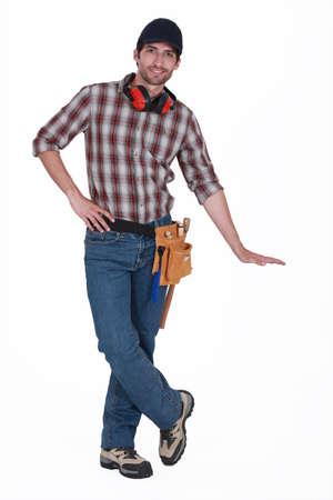 journeyman technician: craftsman showing the height of something