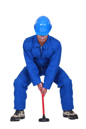 exaggerate: Landscape picture of plumber with plunger