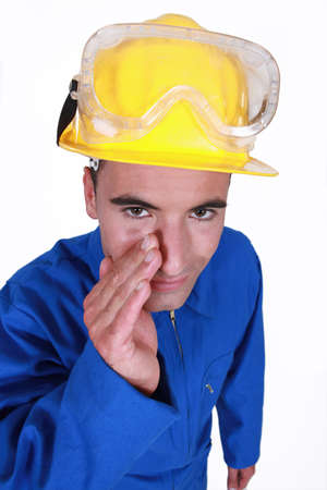 boiler suit: Worker wearing blue boiler suit
