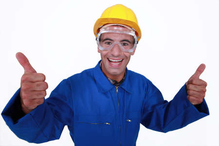 Elated tradesman giving two thumbs up photo