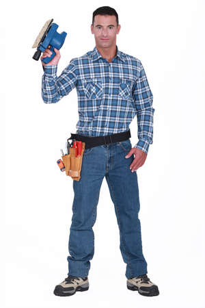 sander: Man with an electric sander Stock Photo