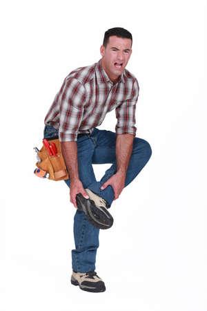 Builder avec une blessure au pied photo