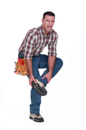 lame: Builder with foot injury Stock Photo