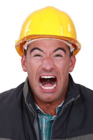 Portrait of construction worker screaming photo